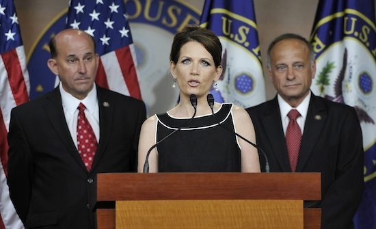 Bachmann holds a news conference with Gohmert and King to discuss the debt ceiling and military benefits, at the U.S. Capitol in Washington