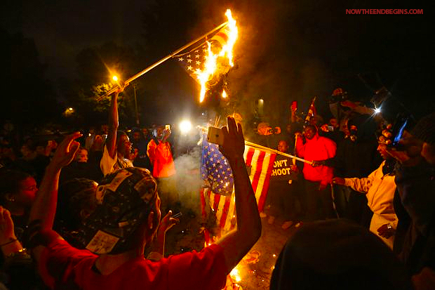 ferguson-protesters-st-louis-burn-american-flags-on-grand-boulevard