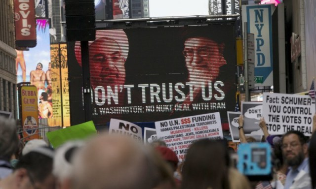 An image of Iranian leaders is projected on a giant screen in front of demonstrators  during a rally apposing the nuclear deal with Iran in Times Square in the Manhattan borough of New York